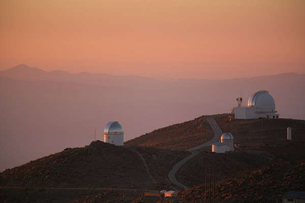 Sunset over telescopes at Las Campanas Observatory in Chile