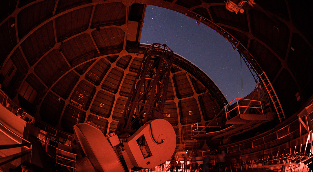 Telescope at Mount Wilson Observatory taken at night with stars visible