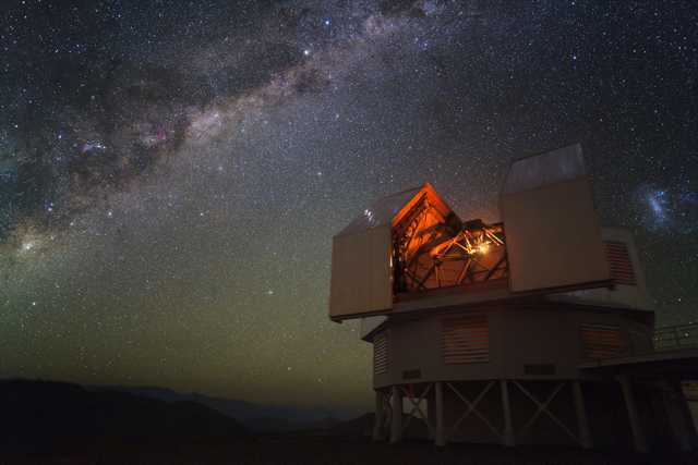 An image of the Magellan telescope peering out into space.