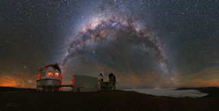 Image of the Milky Way spanning the sky over the Magellan Telescopes at Las Campanas Observatory, image credit: Yuri Beletsky