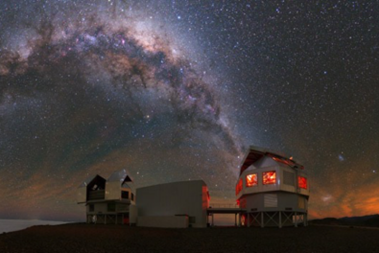 View of both Magellan telescopes with the Milky Way as a backdrop.