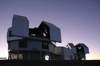 Photo of the twin Magellan Telescopes open at dusk atop Cerro Las Campanas.  Photo by Matias del Campo.