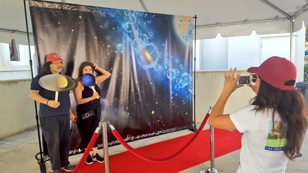 A couple has their picture taken on our redshift carpet