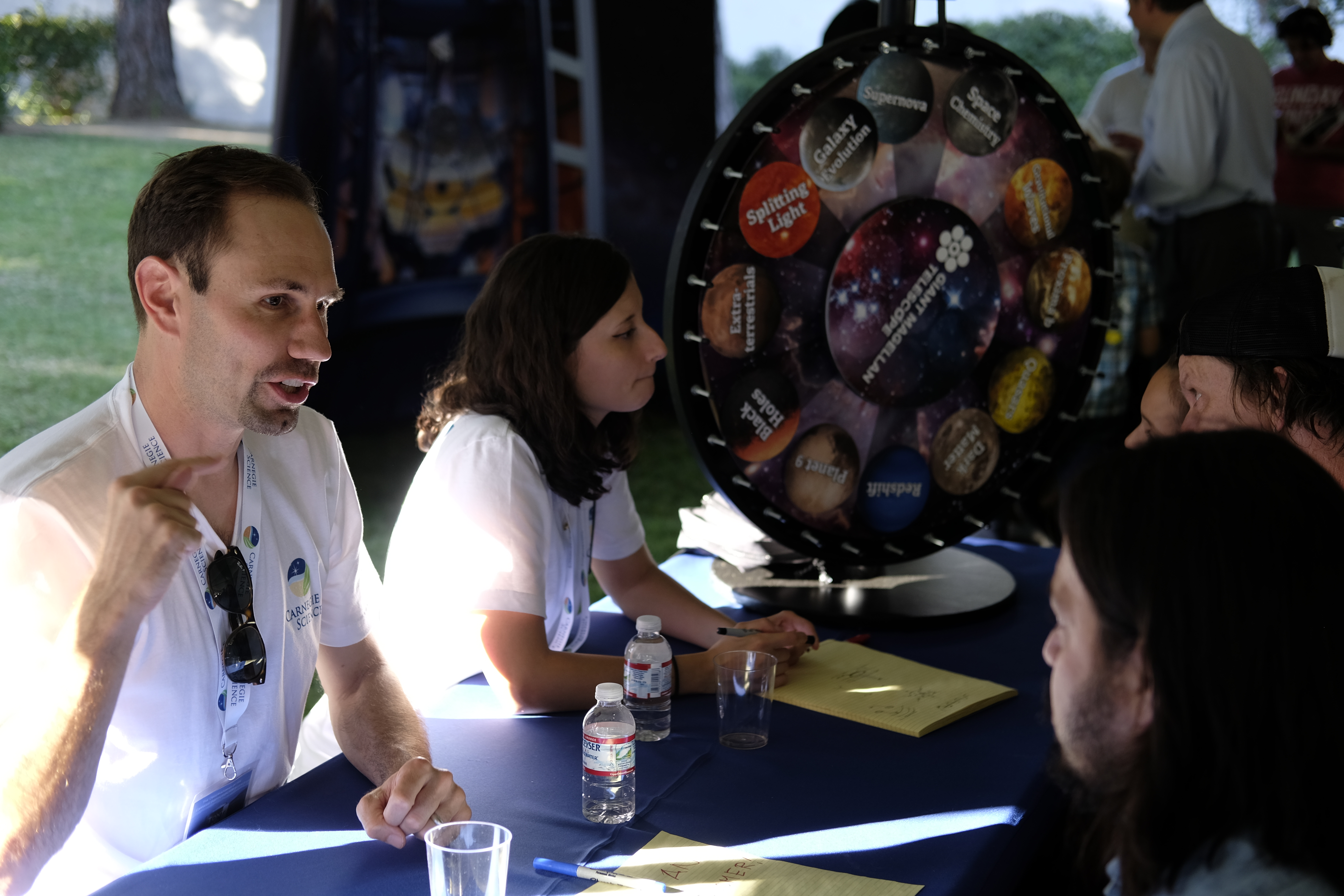 Astronomers answer questions at the Ask an Astronomer table